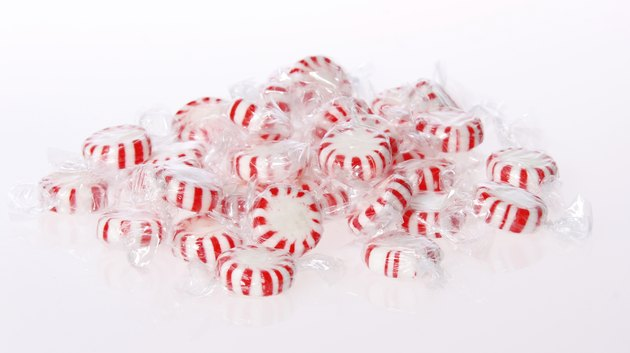 Peppermint candy pile on white background. Red striped