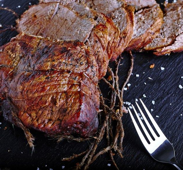 Roast beef on black stone board
