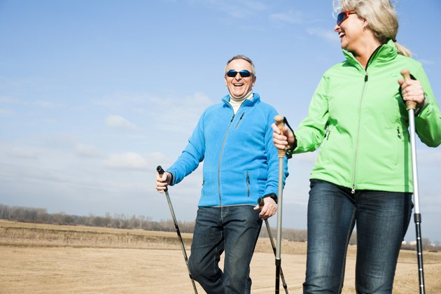 Happy couple doing nordic walking
