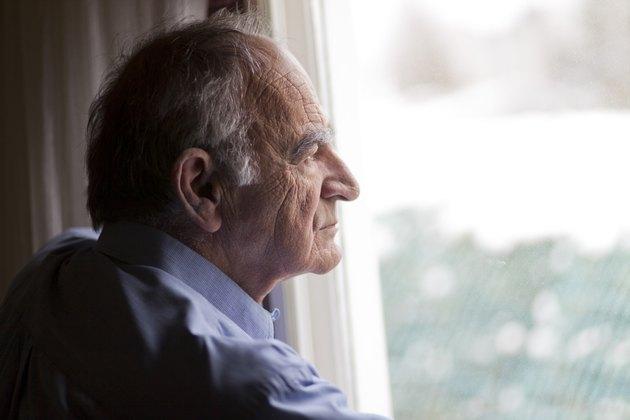 Close-up of a senior man contemplating