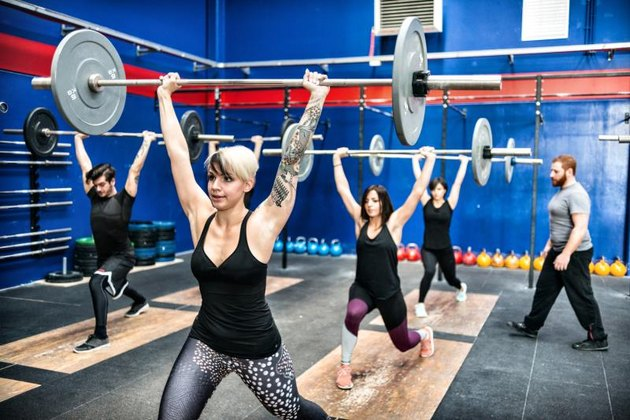 CrossFit gym with guys and gals weightlifting.