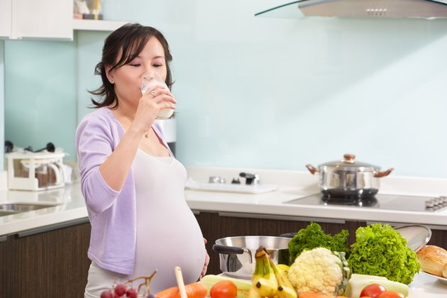 Pregnant lady drinking milk