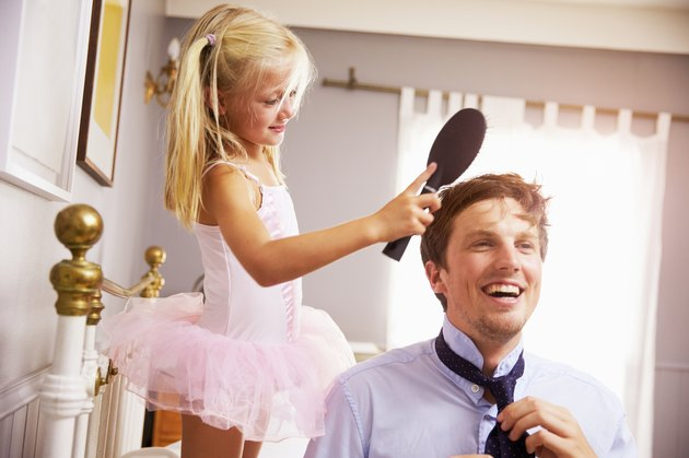 Daughter Helps Father To Get Ready For Work, Brushing Hair