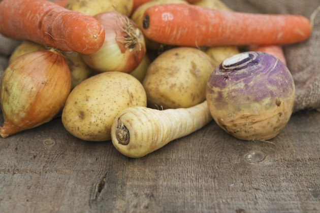 Winter seasonal vegetables including potatoes parsnips swede and carrots