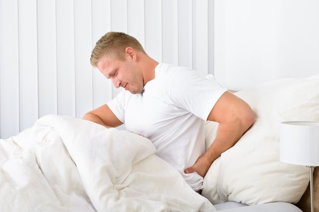 Young Man Suffering From Backpain