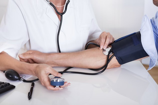 Doctor taking a patients blood pressure
