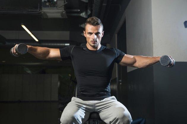 Bodybuilder Doing Exercise For Shoulder