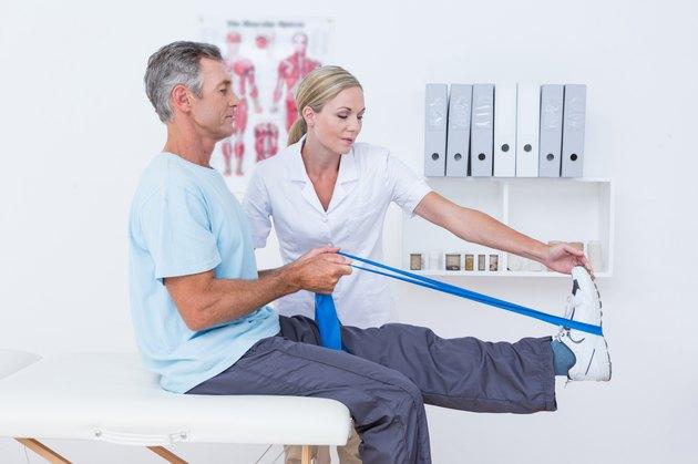 Doctor examining her patient back legs