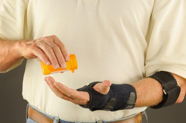 Man taking pain anti-inflammatory tendinitis medication