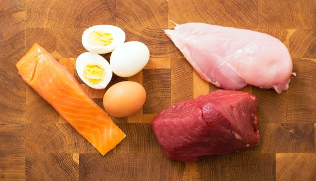 Meet, fish, eggs on kitchen table