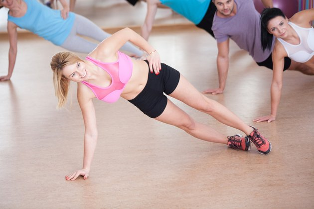 Fitness instructor showing advanced exercise