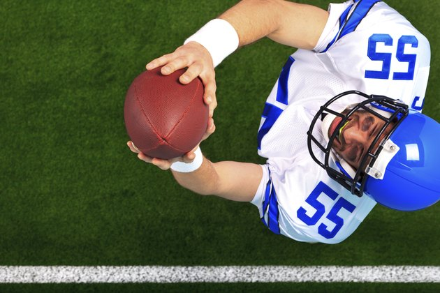 Overhead American football player catching the ball