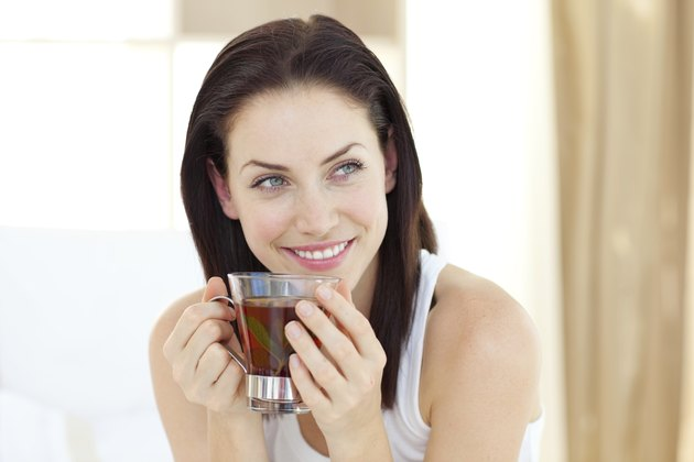 Attractive woman drinking tea