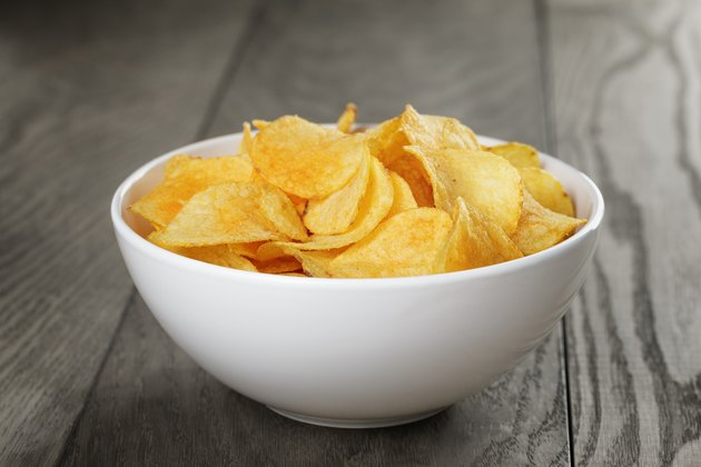 organic potato chips in white bowl on wood table