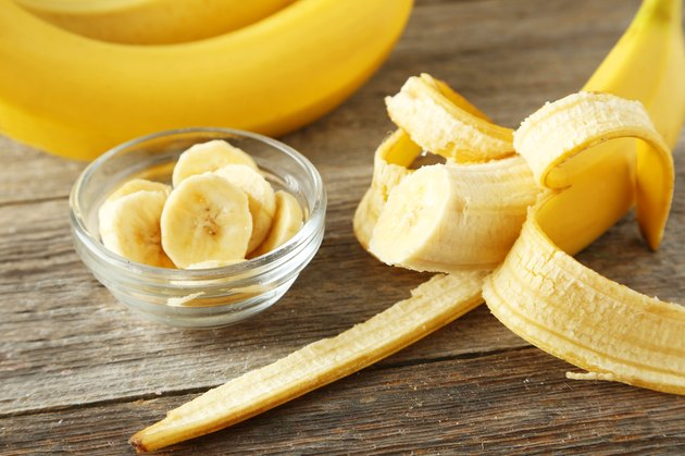 Bananas on grey wooden background