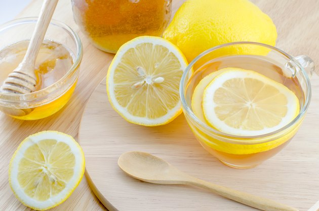 Honey lemon tea on wooden table