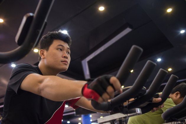 Man focus on doing exercise in the gym