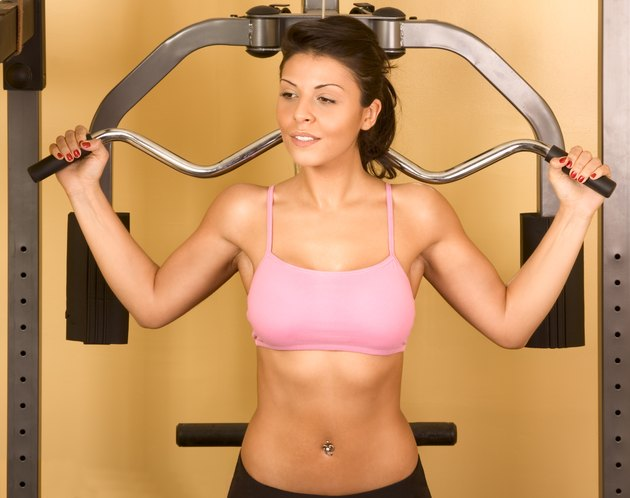 Women working out on weight-lifting machine