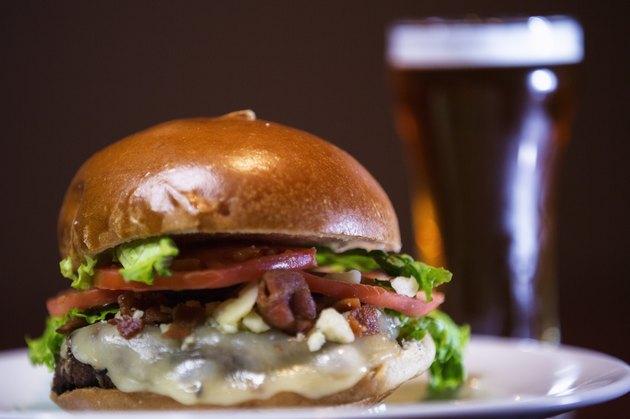 Bacon cheeseburger and a draft beer .