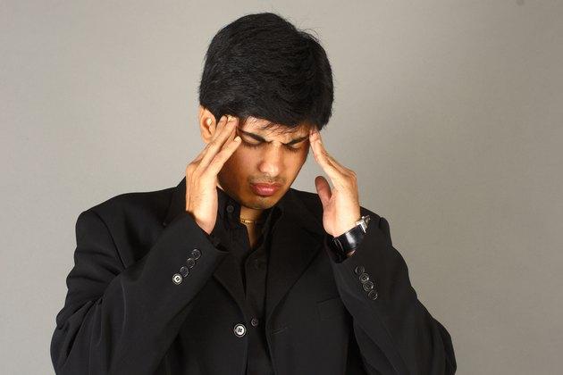 Close-up of a businessman under stress