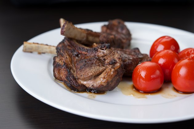 Grilled lamb chops on a white plate