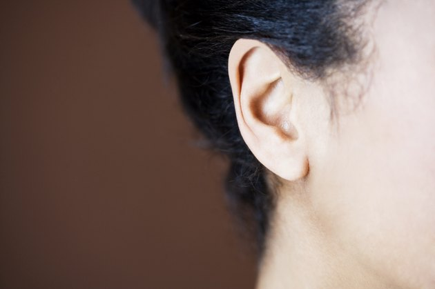 Close-up side view of womans head showing ear and jawline