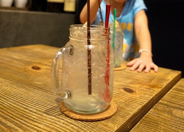 Kid is drinking Lemon Cocktail