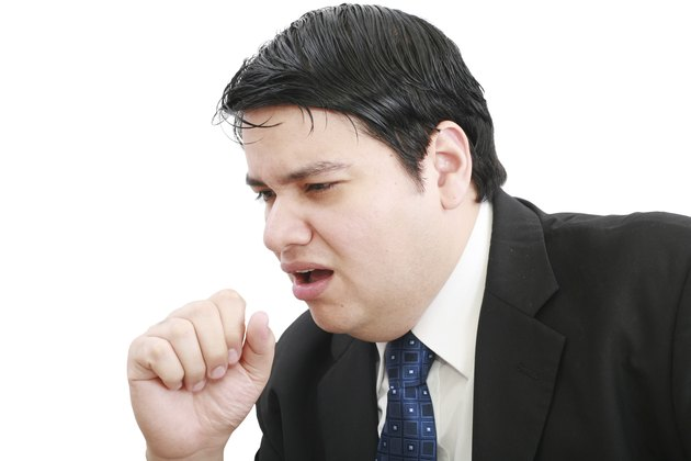 young ill businessman coughing