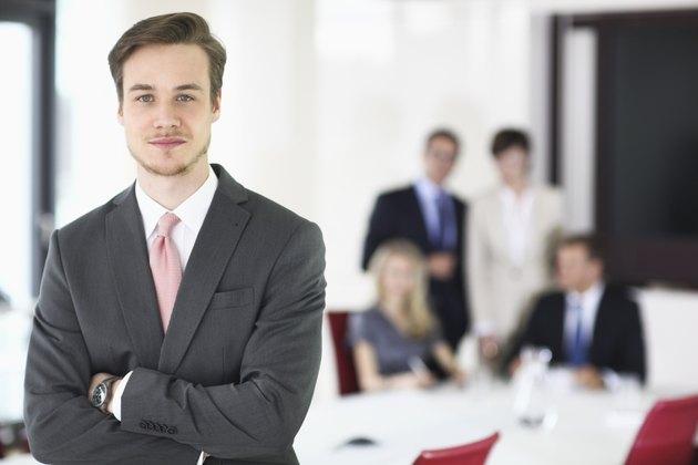 Businessman in meeting room, portrait