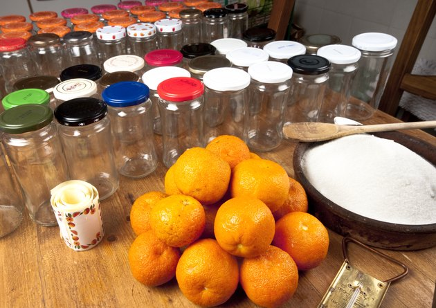 Seville oranges, sugar, and jam jars.