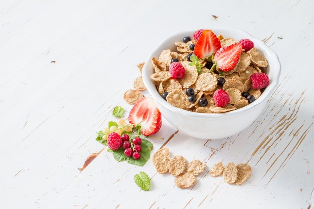 Cereal, strawberry, milk, white wood background