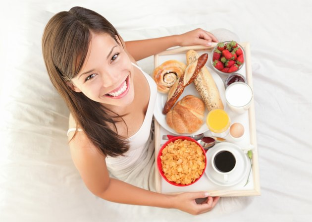Breakfast in bed woman