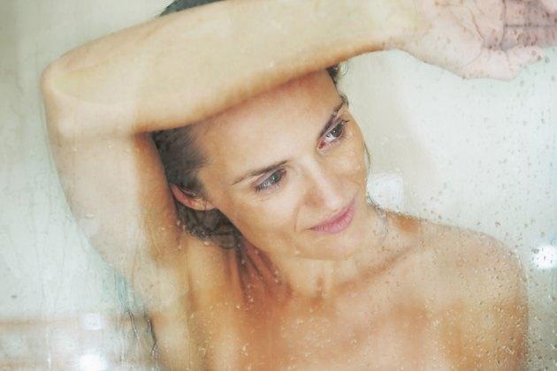 portrait of young woman behind shower door