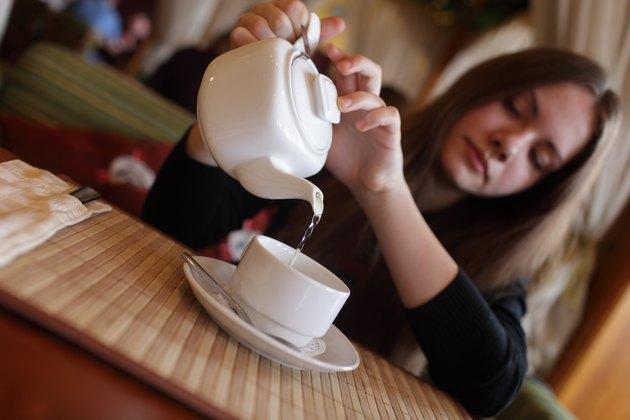 Teen pouring green tea