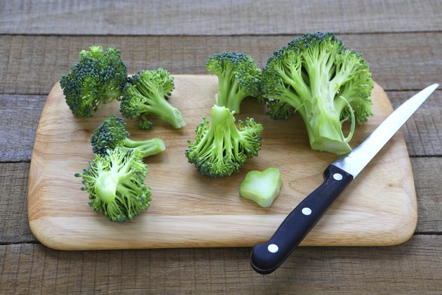 fresh broccoli on cutting board