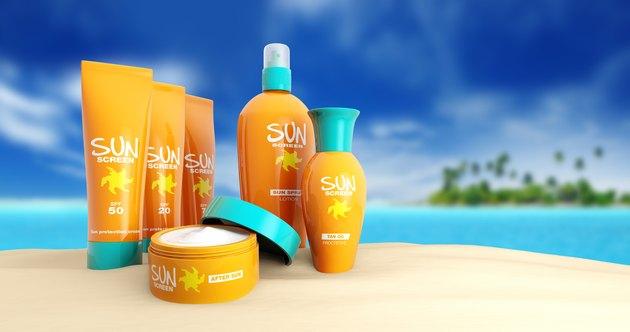 set of sun cream in a tropical beach