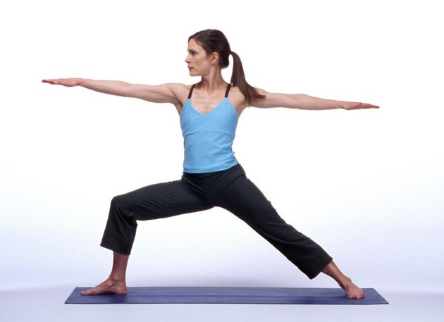 Caucasian Woman Posing On A Blue Yoga Mat