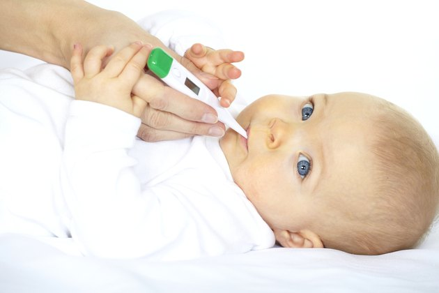 baby with clinical thermometer
