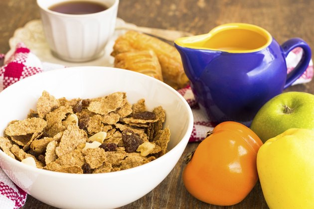 delicious healthy granola with dry fruits, nuts and milk.