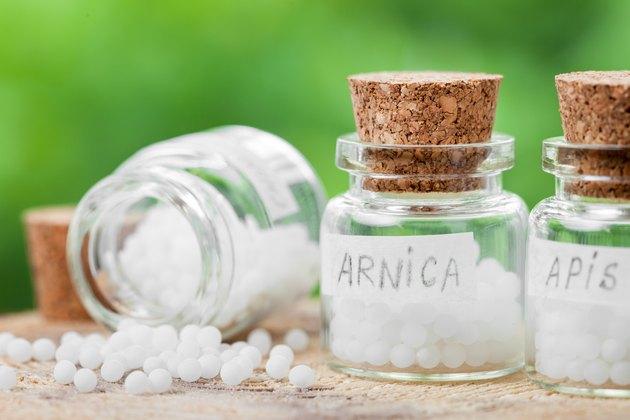 Three bottles of homeopathy globules