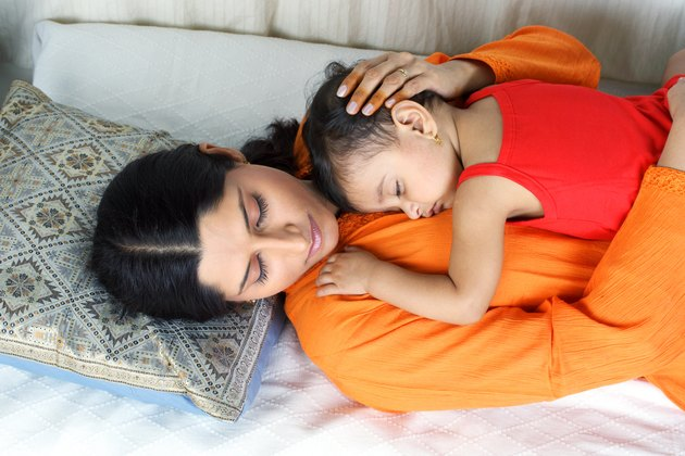 Top angle view of a mother and child sleepping