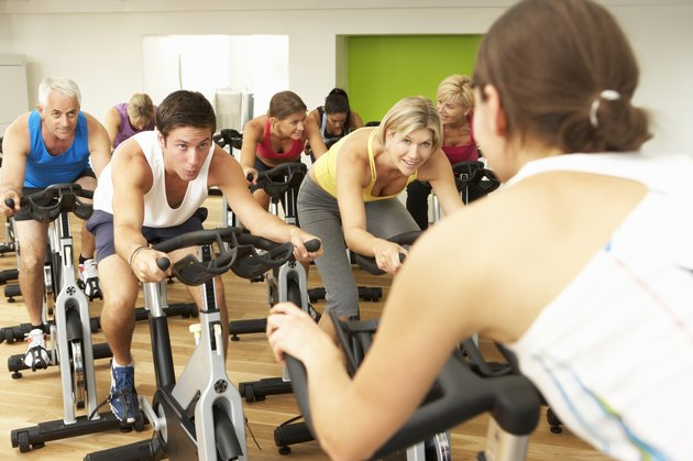 Group Doing Spinning Class In Gym