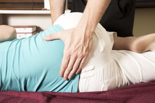 Chiropractor massage patient lower back ,spin