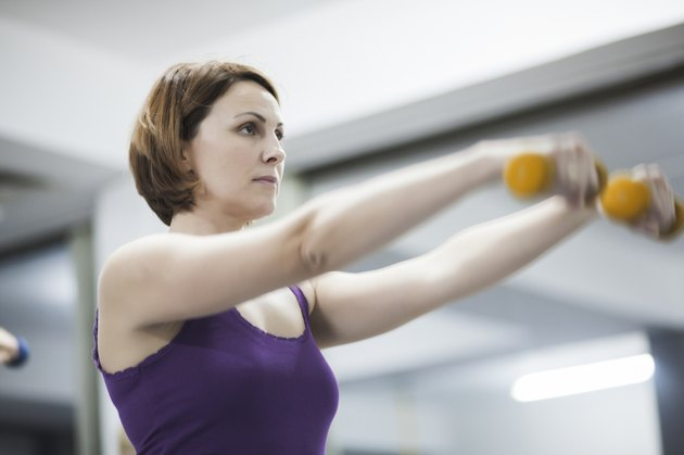 Beautiful woman exercising pilates