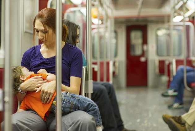 Woman Nursing on Subway