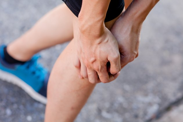 Runner touching painful knee. Athlete runner training accident.