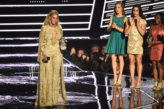 NEW YORK, NY - AUGUST 28: Beyonce accepts the Best Female Video award presented by Madison Kocian, Aly Raisman, and Simone Biles onstage during the 2016 MTV Video Music Awards at Madison Square Garden on August 28, 2016 in New York City.  (Photo by Michael Loccisano/Getty Images)