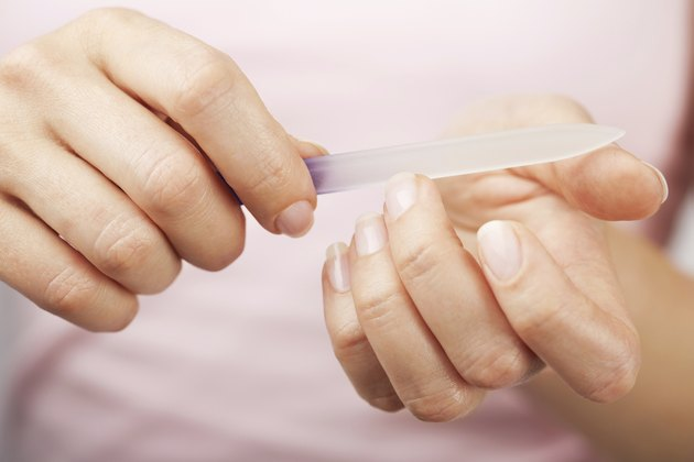 beautiful woman hands with nail file