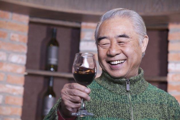 Senior Man Holding Wineglass, Portrait