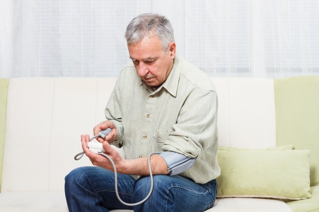 Senior man measuring blood pressure